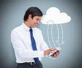 Businessman holding a tablet pc connecting with cloud computing — Stock Photo