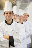 Chefs in line smiling — Stock Photo