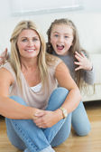 Little girl about to scare her mother — Stock Photo
