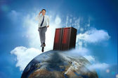 Businessman racing on top of the world beside server — Stock Photo