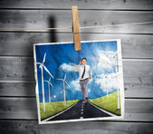 Photo of businessman running on a road hung on a line — Stock Photo