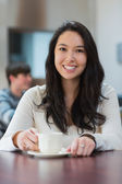 Smiling student in a coffee shop — Stock Photo