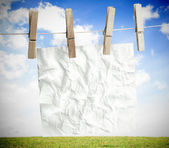 White crumpled paper hung on a laundry line — Stock Photo