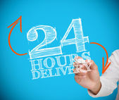 Businesswoman writing 24 hours delivery — Stock Photo