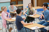 Chatting students in the classroom — Stock Photo
