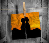 Torn photo of couple hung with a peg on a line — Stock Photo