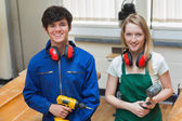 Two students holding a driller and a hammer — Stock Photo