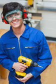 Student standing while holding a driller — Stock Photo