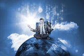 Businessman sitting on top of the world with data server — Stock Photo