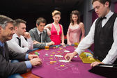 Looking at dealer dealing blackjack cards — Stock Photo