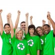Stock Photo: Group of smiling activists raising arms