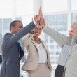 Happy business team high fiving — Stock Photo