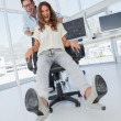 Stock Photo: Designers having fun with on swivel chair