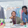 Fashion designers working together in a creative office — Stock Photo #26979333