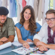 Team of fashion designers smiling to the camera — Stock Photo