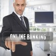 Stock Photo: Businessman touching the term online banking