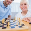 Father playing chess with his little boy — Stock Photo #26979833