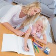Mother and daughter drawing together at table — Stock Photo