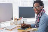 Smiling graphic designer using a graphics tablet — Stock Photo