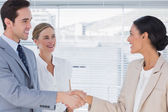 Business shaking hands in the office — Stock Photo