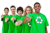 Smiling group of environmental activists giving thumbs up — Stock Photo