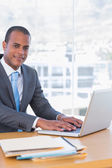 Happy businessman working on his laptop — Stock Photo