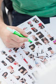Photo editor marking photographs of contact — Stock Photo