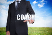 Businessman selecting coach word — Stock Photo
