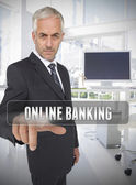 Businessman touching the term online banking — Stock Photo