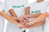 Group of volunteers putting hands together — Stock Photo
