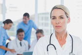 Serious doctor standing — Stock Photo