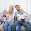 Family playing video games together — Stock Photo