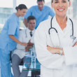 Pretty doctor with arms folded — Stock Photo