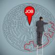 Businessmtrying to find job in maze — Stock Photo #26980425