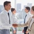 Partners giving a handshake — Stock Photo