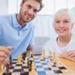 Father and his little boy playing chess — Stock Photo