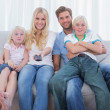 Parents and children watching TV — Stock Photo