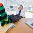 Businessman having a nap with feet on the desk — Foto Stock