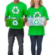Stock Photo: Two environmental activists carrying box of recyclables