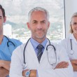 Group of doctor and nurses standing together — Stock Photo