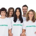 Group of wearing volunteer tshirt — Stock Photo