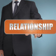 Businessmselecting word relationship written on orange ta — Stock Photo #26981305