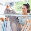Fashion woman choosing dress — Stock Photo #26981369