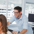 Stock Photo: Smiling designers playing on swivel chair