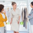 Two fashion designers looking at model — Stock Photo