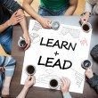 Learn plus lead written on a poster with drawings of charts — Stock Photo