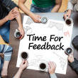 Time for feedback written on a poster with drawings of charts — Stockfoto