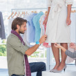 Stock Photo: Fashion designers adjusting dress