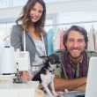 Fashion designers and chihuahua — Stock Photo #26982917
