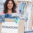 Volunteer holding clothes donation box — Stock Photo #26982975
